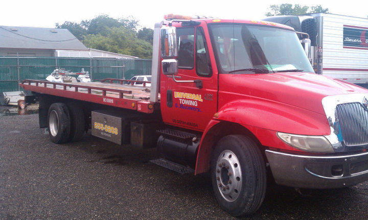 We tow almost anything and we tow with care ! Flat bed towing with soft straps, 4X4 recoveries, accidents, equipment moving, container hauling, we do it all.