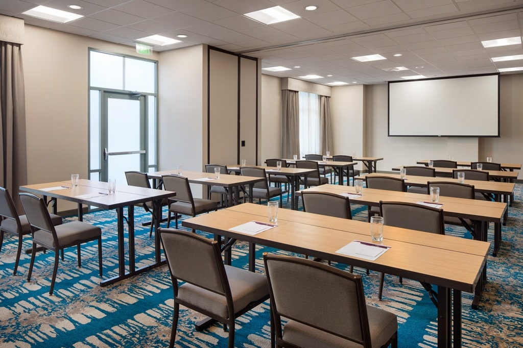 The Shores Meeting Room Classroom Setup - Our recently renovated hotel offers everything you need to host a successful professional or social event including high-speed Wi-Fi, AV equipment and customizable catering.