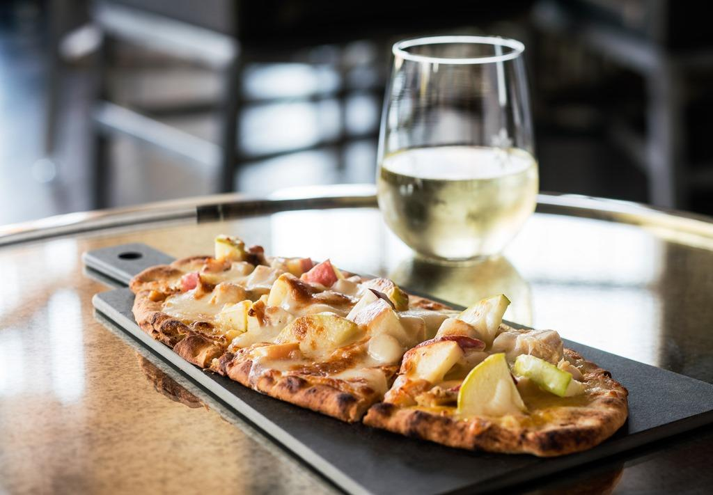 Nineteen26 Bar & Lounge Flatbread & Wine - If you assumed combining chicken and apples was a poor idea, think again. Our Chicken Apple Flatbread is one of several delicious appetizers sure to make you