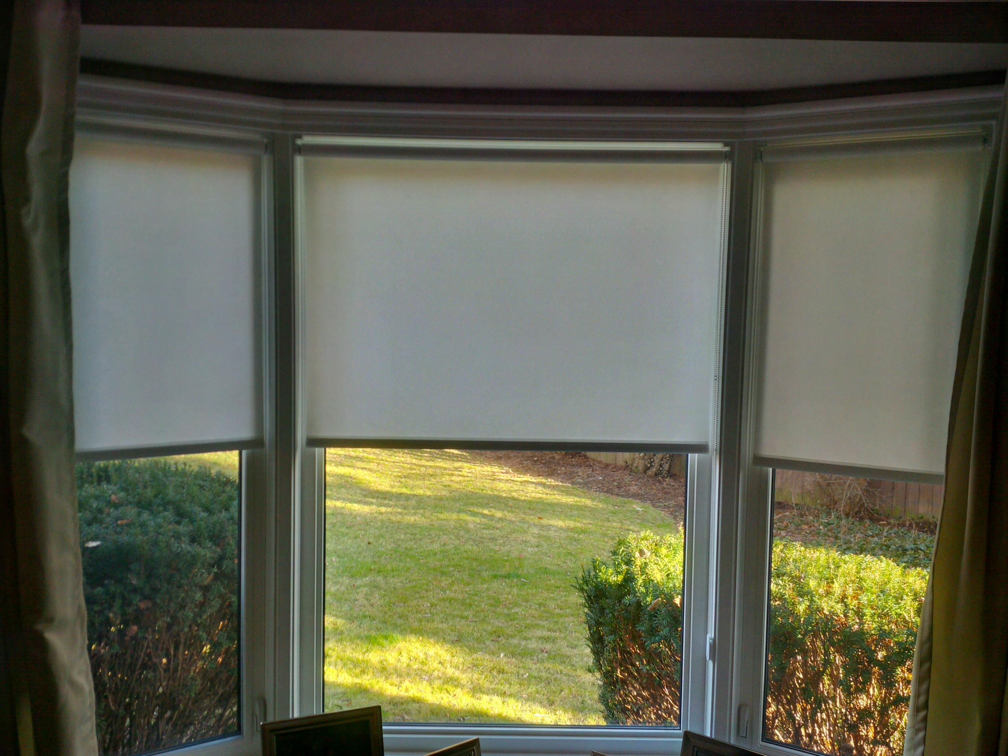 """Budget Blinds à Waterloo: Finding a product that can fully mount inside a window opening with only a depth of about 1.25"""" can be a challenge...until you call Budget Blinds! We have more unique and exclusive window coverings options than anyone else. This image shows a BECE privacy roller shade with no valance."""