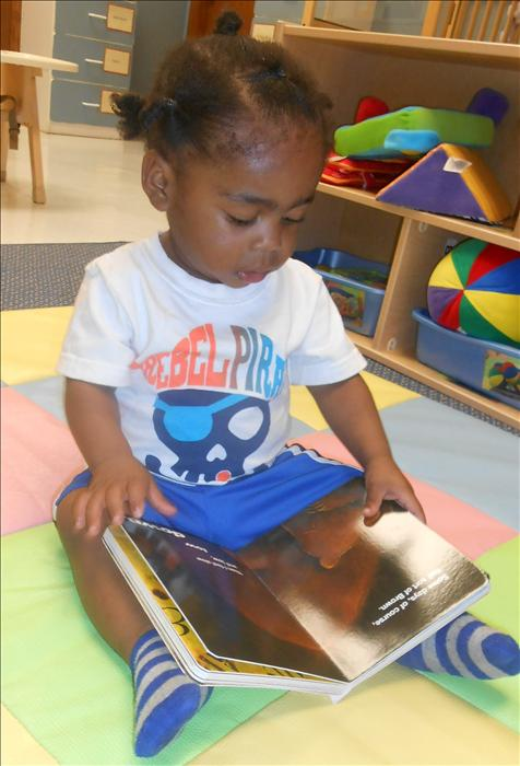 This is What Learning Looks Like: Building brain power as well as pre-literacy skills that develops a love for reading.