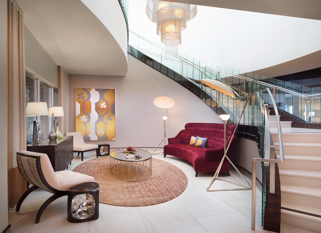 Lobby Living Area - Discover the sleek, boutique-style setting of our elegant lobby space, perfect for socializing with friends and family before a night out on the town.