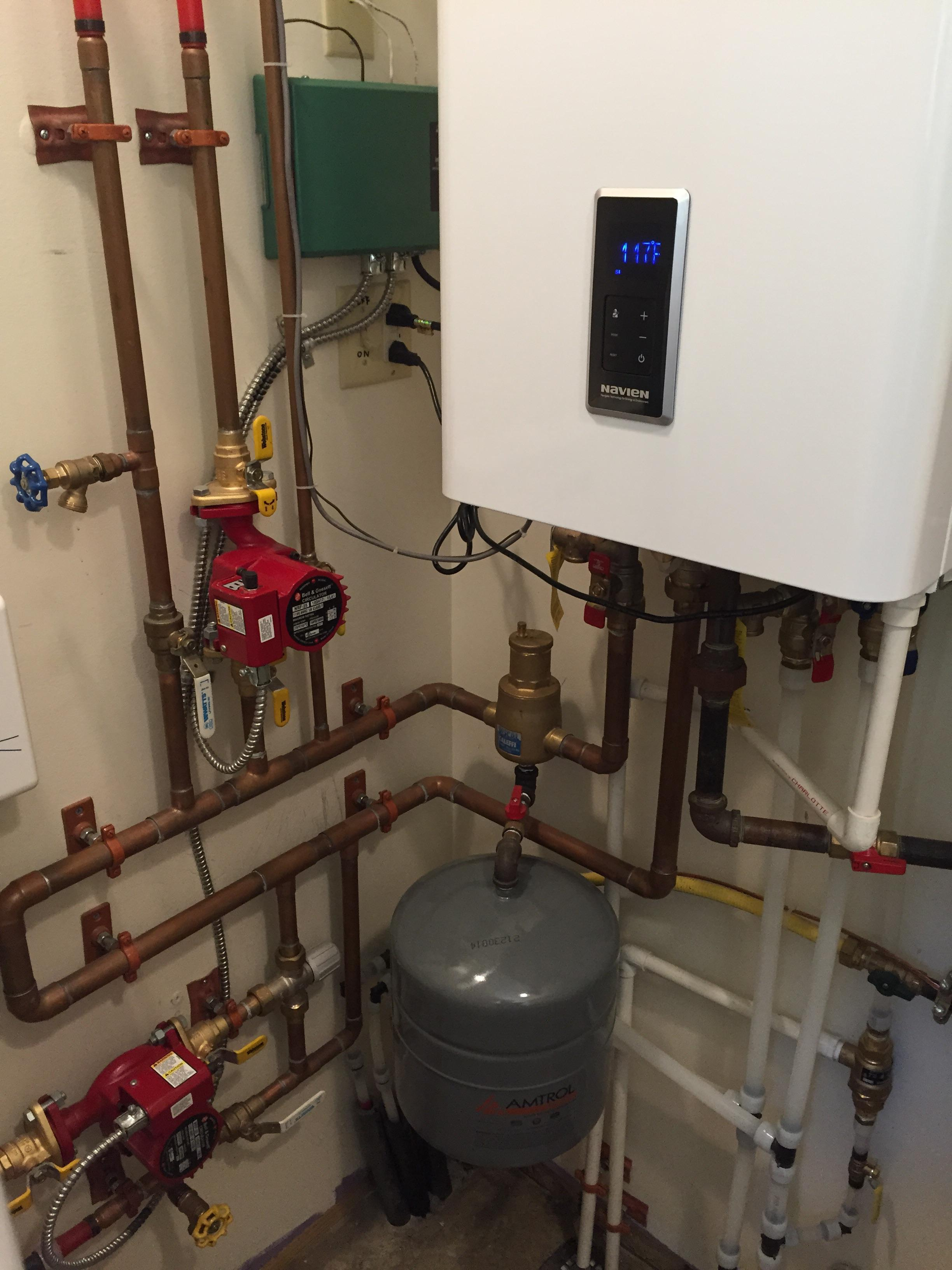 95% Efficient Navien NCB 180 with 1 infloor radiant zone, & 1 hot water baseboard zone.