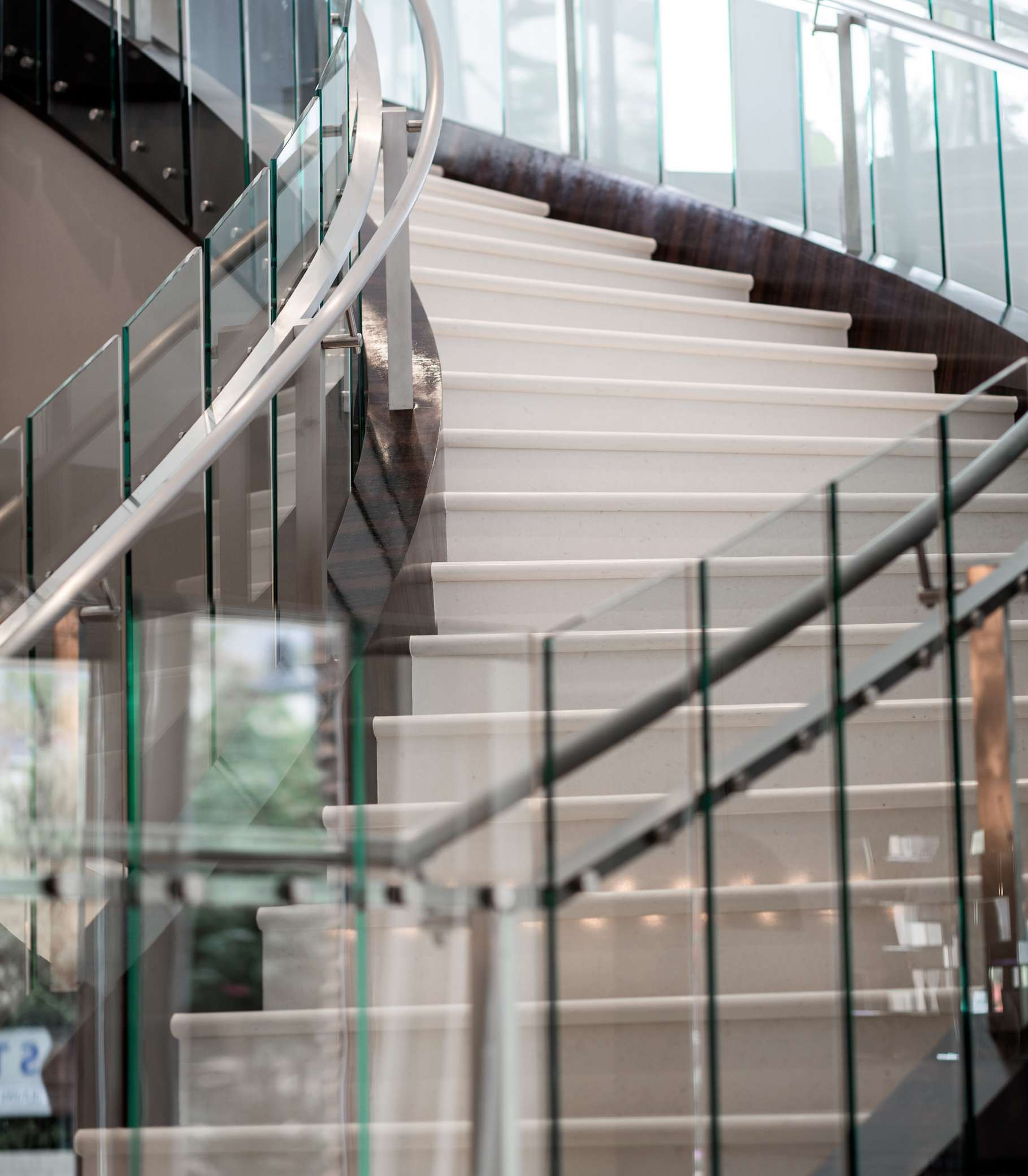 Atrium Staircase - Feel like a Hollywood movie star while you walk down our stunning, atrium-style staircase in the center of our hotel.