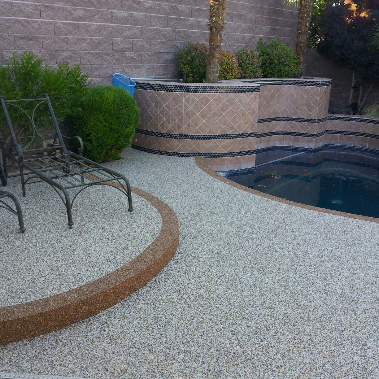 We just finished a new pool deck installation of Pebble