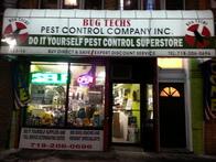 Bug Techs office sign illuminated at night.