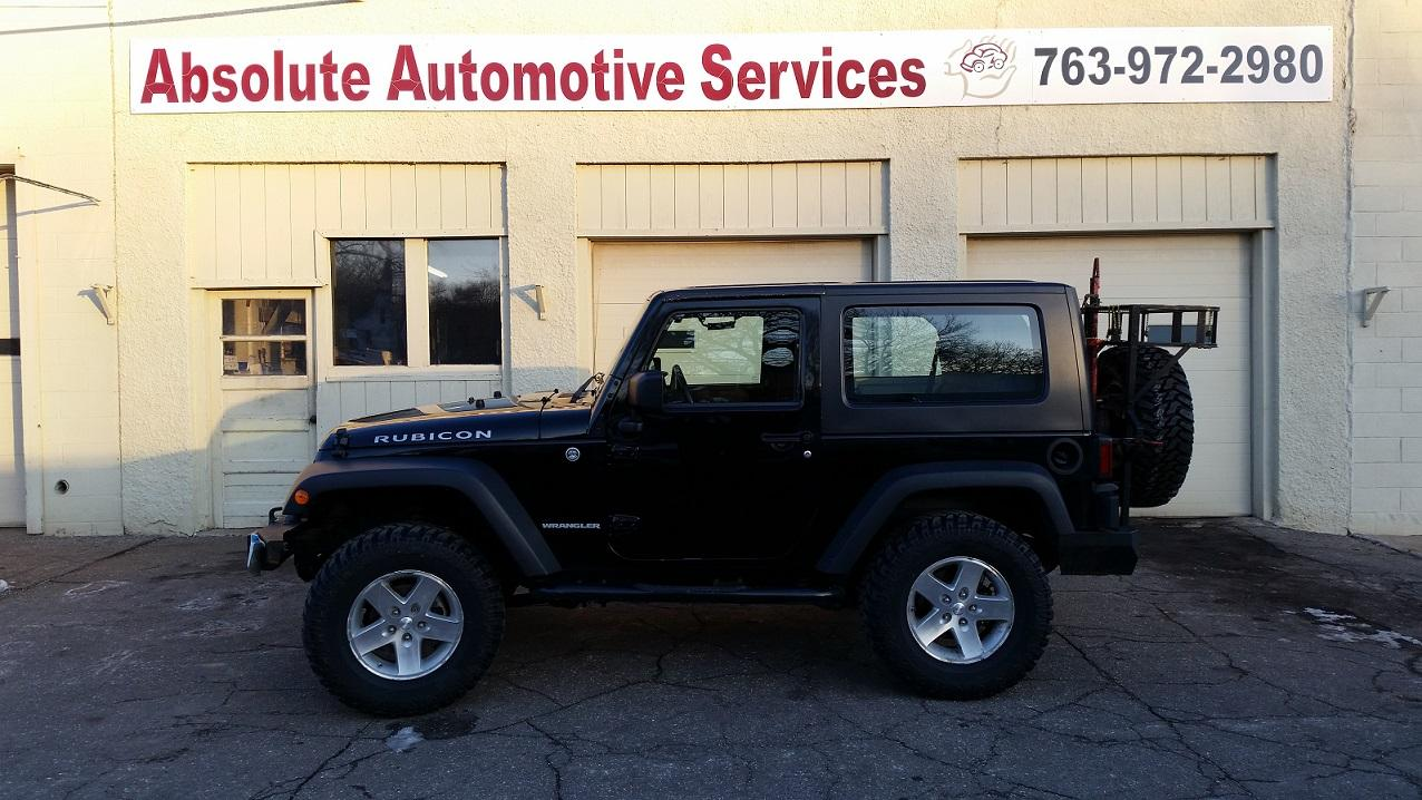 New suspension lift and rock grabbing tires done at Absolute Automotive Services in Delano, MN.