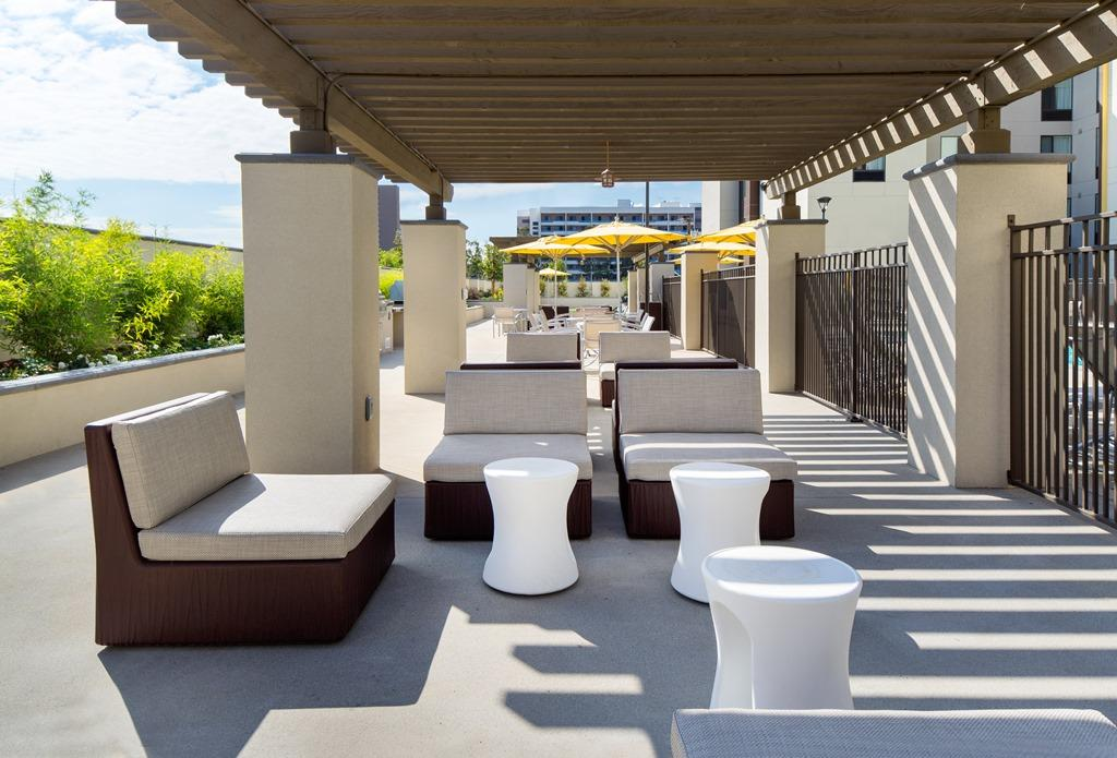 Outdoor Seating Area - Stay shaded from the sun in our luxurious lounge area, perfect for entertaining clients or socializing with friends.