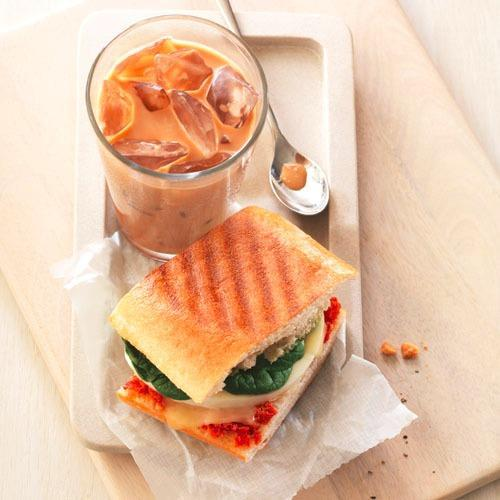Start your morning with the Mediterranean Egg White Sandwich on Ciabatta and an iced coffee.