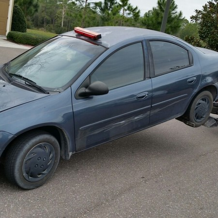 2002 Dodge Neon, 4 door. we buy junk cars, trucks, buses, vans.