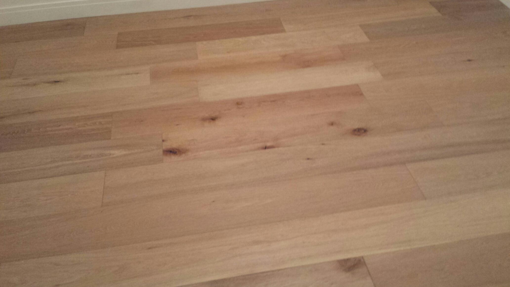 Oak flooring sanded and finished in natural stain color with 4 coats of semi gloss polyurethane.
