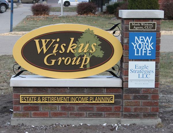 Wiskus outdoor business sign