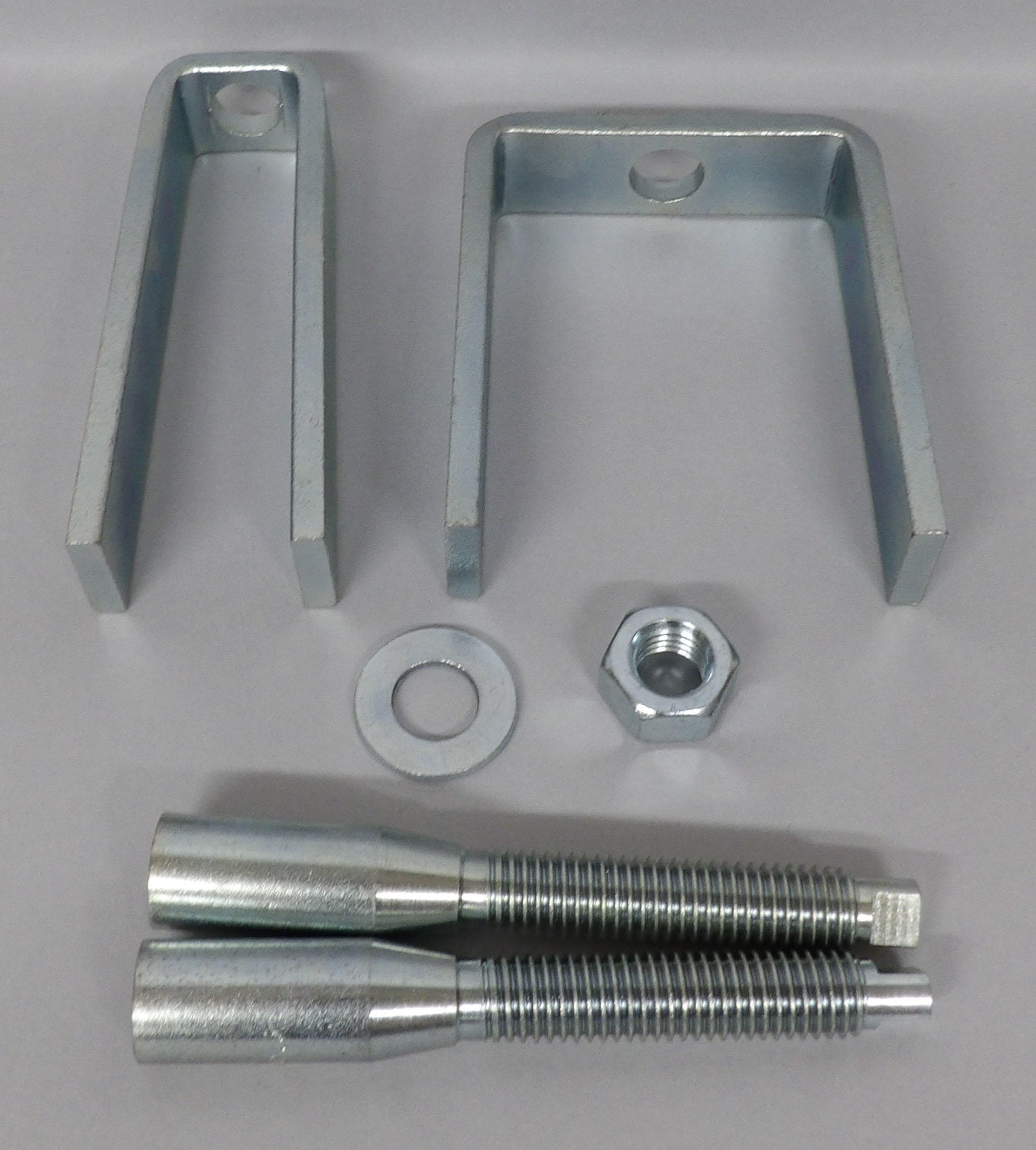 CG95B Steering Wheel Lock Plate Remover Designed for airbag equipped Saginaw steering columns. This set includes two zinc plated pullers (narrow and wide bridge), and two pressure screws: sizes 9/16