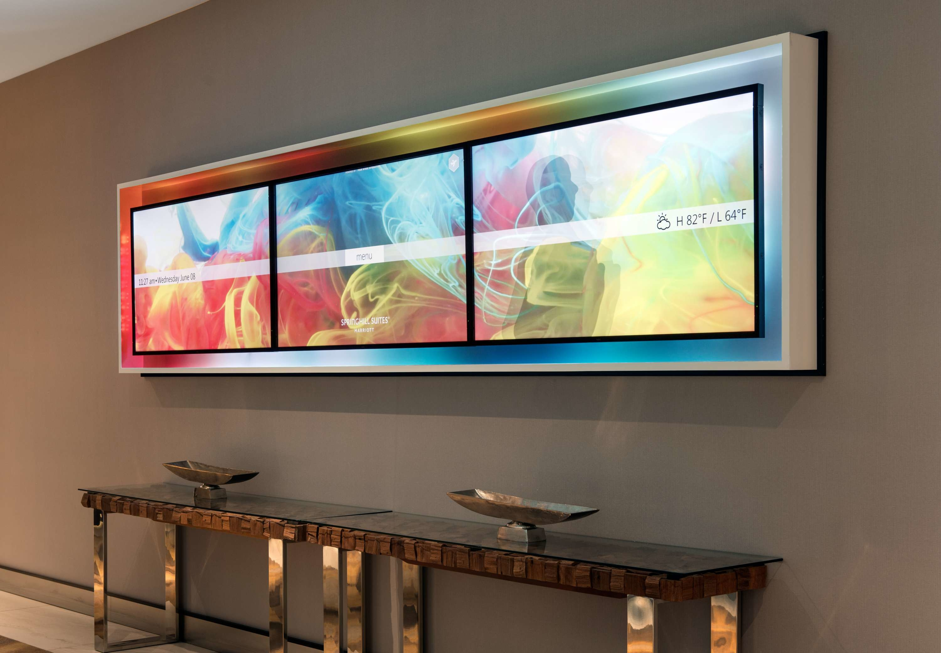 Digital Art Wall - At SpringHill Suites Los Angeles Burbank/Downtown, we constantly strive to push the envelope on innovation and technology. Located in the foyer, this sleek digital board provides up