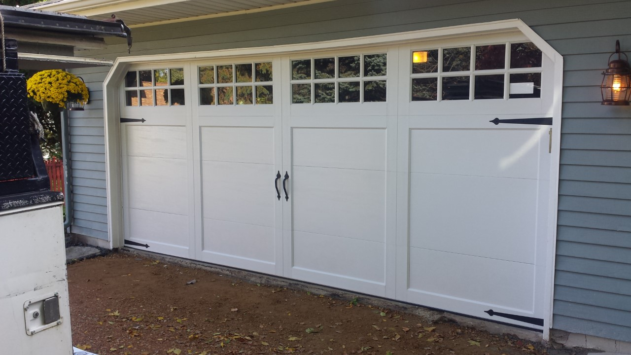 Black hawk aaa garage door bloomington mn company page for Garage door repair tampa