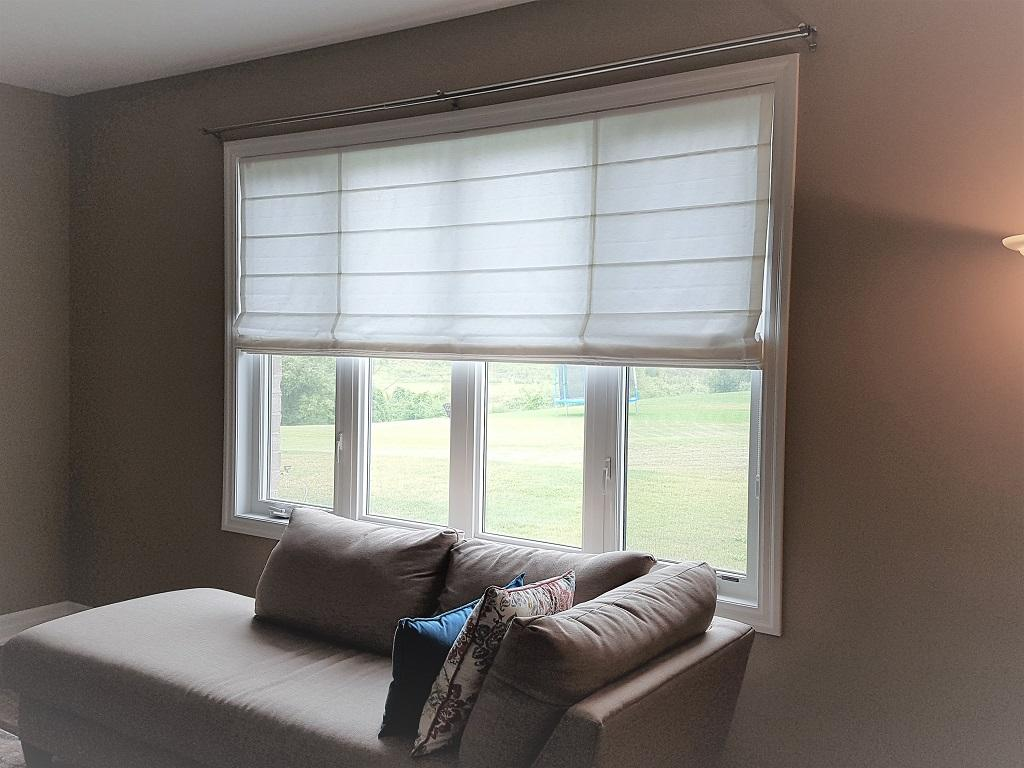 Budget Blinds à Waterloo: Sometimes the best way to introduce fabric into a space isn't drapery, it's a roman shade.