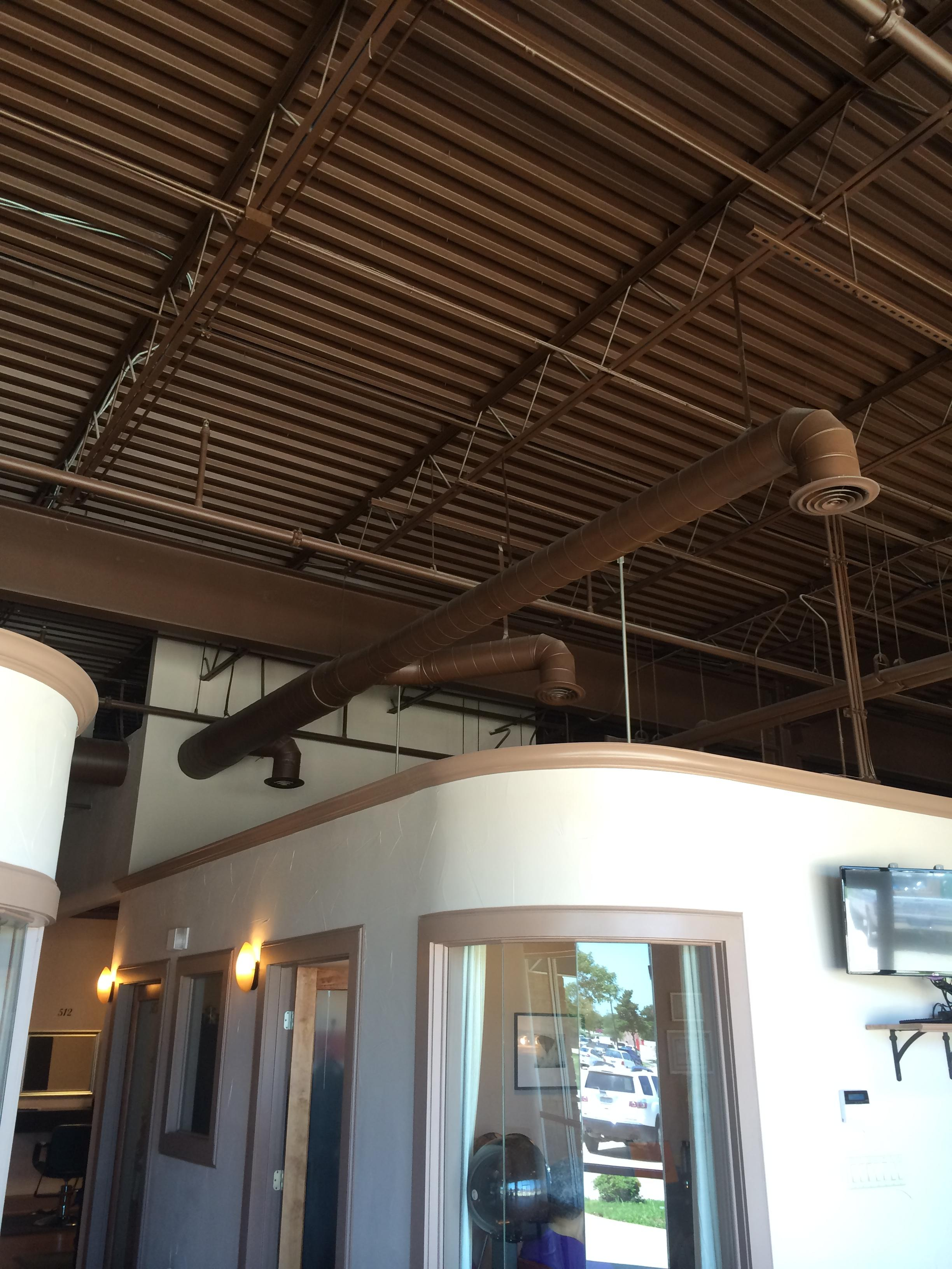 Salon we did complete install from the equipment to new exposed duct work