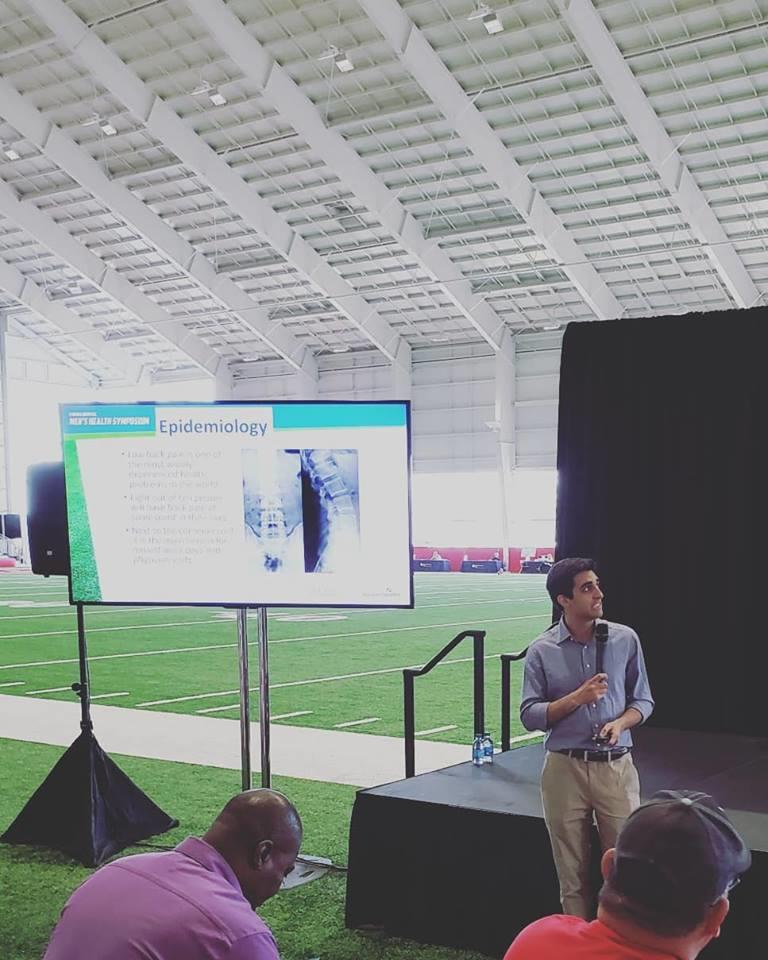 Dr. Sheyan Armaghani Speaking at the Advent Health Men's Health Symposium at the Tampa Bay Bucaneers Training Facility
