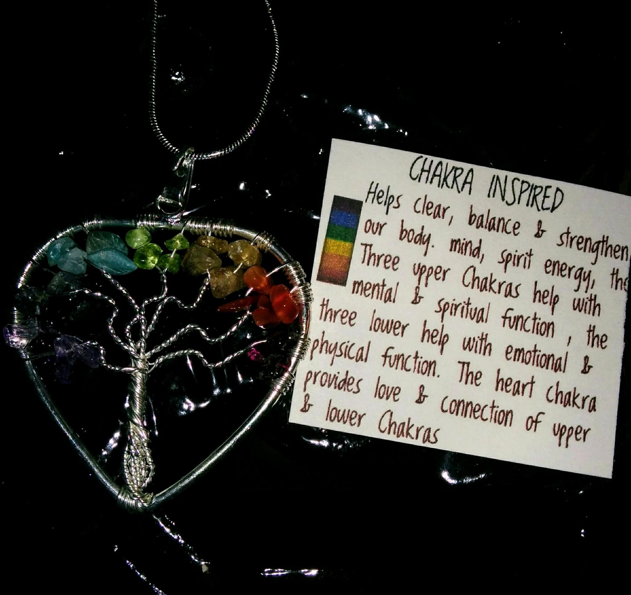 Brassy Lassy Inc in St John's: Chakra gemstone tree pendant on sterling chain, $20