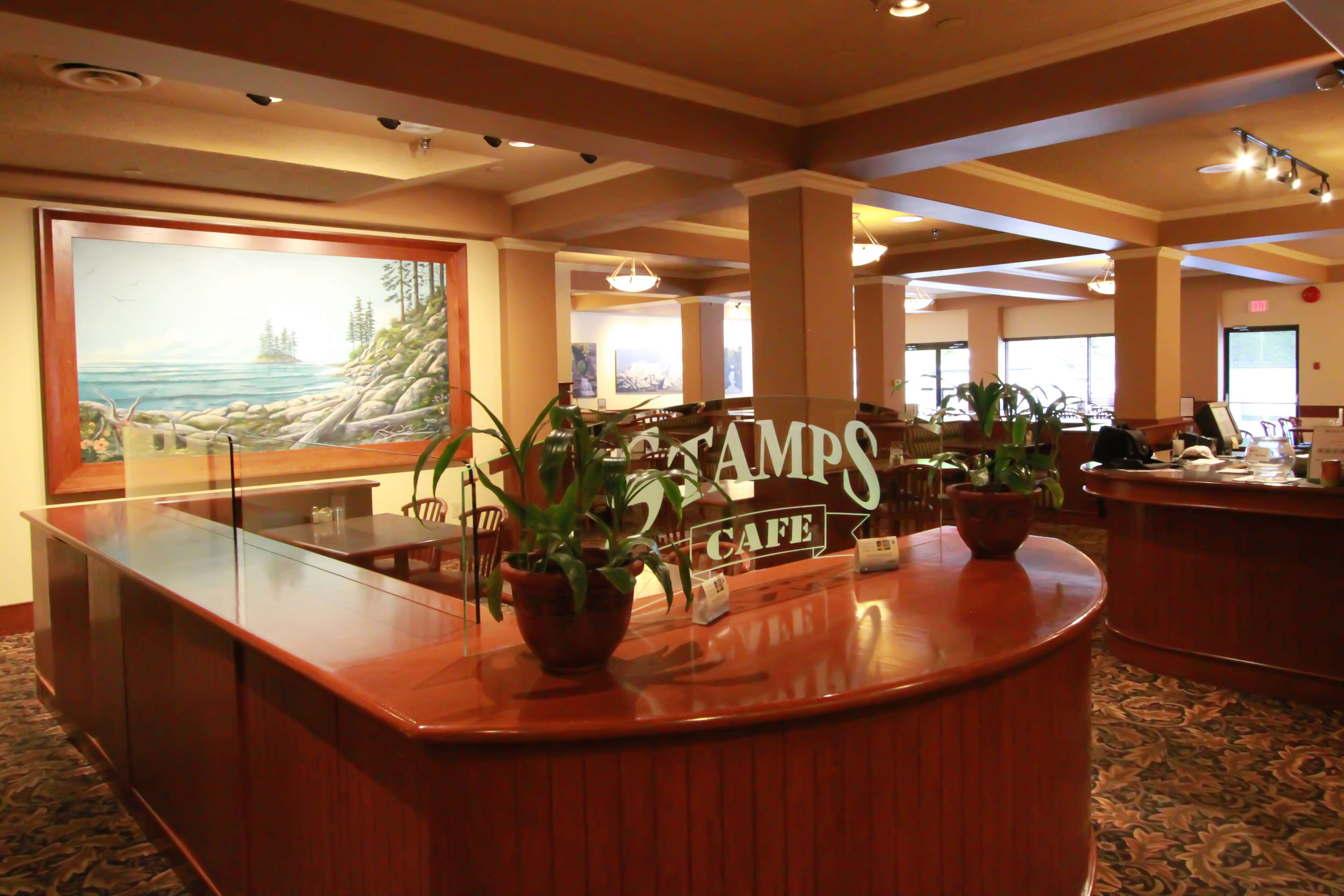 Best Western Plus Barclay Hotel in Port Alberni: Stamp's Cafe has photos and paintings of local attractions.