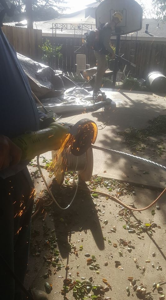 Saul cutting the aircraft quality cable.