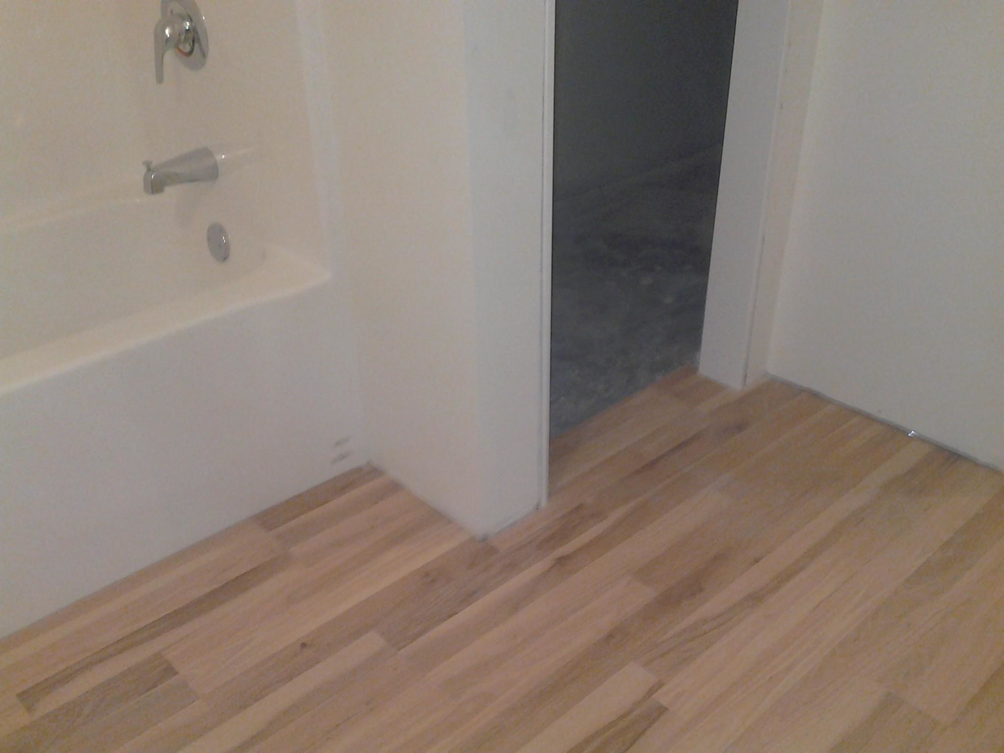 Energy plus home improvements st louis mi business for Laminate flooring michigan