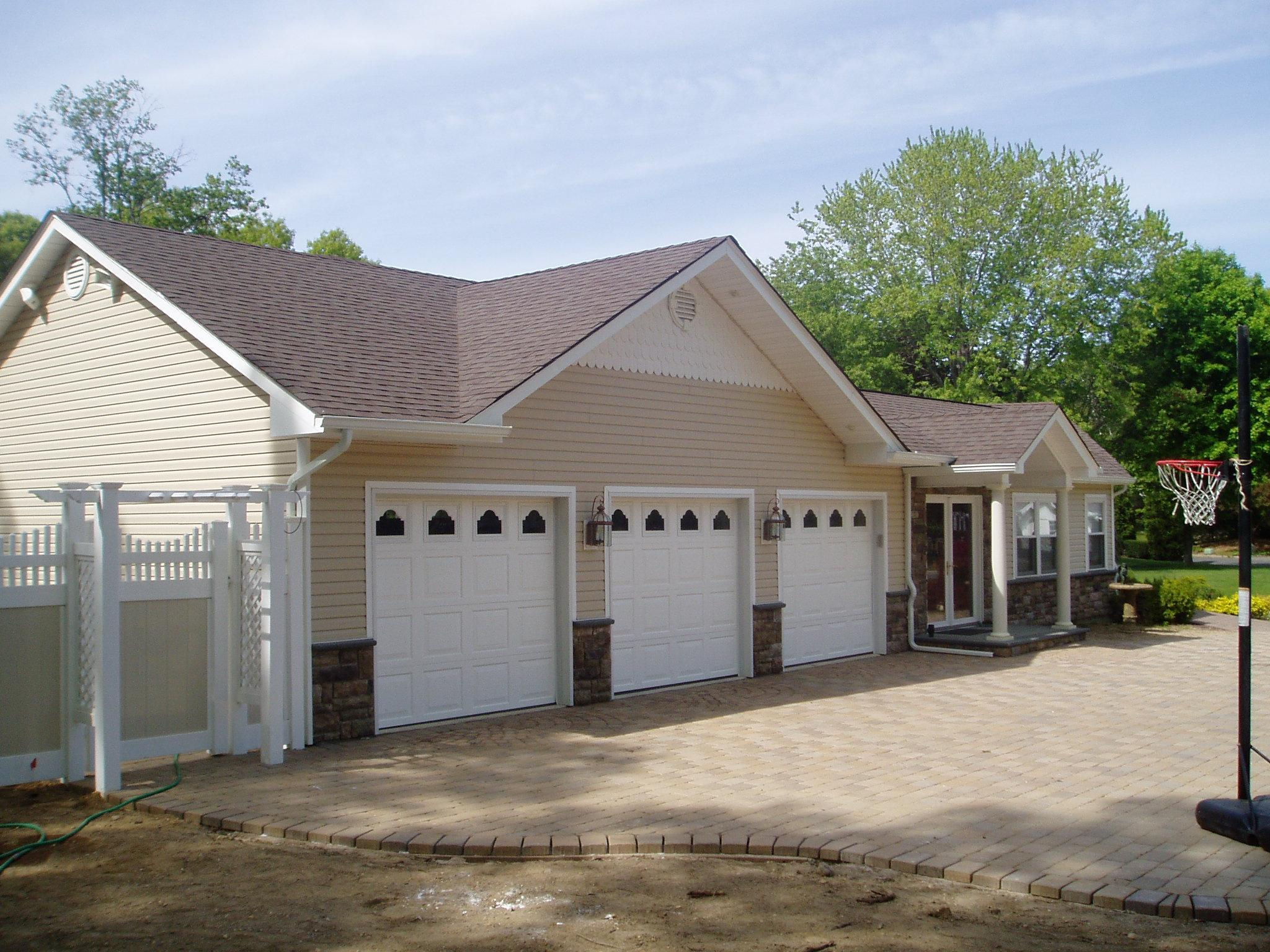 This  is a three car garage and family room and bedroom expansion enhancing the overall look of the existing ranch home.