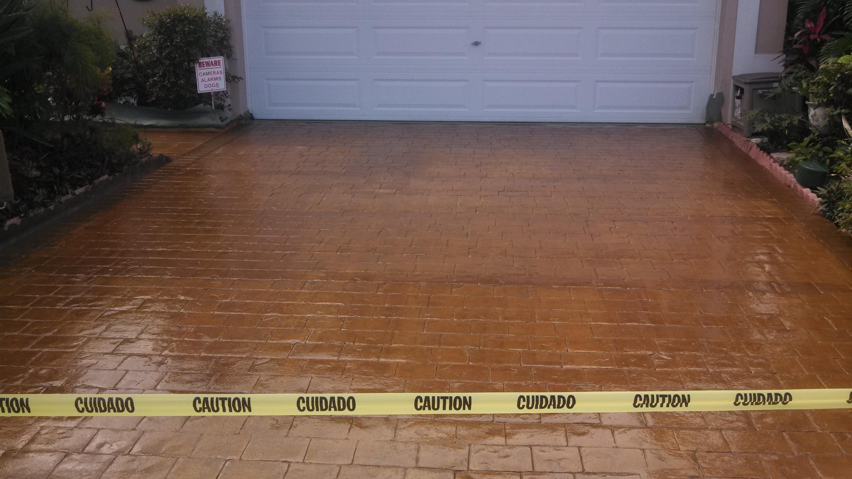 An old stamped concrete driveway after being cleaned and for Best solution to clean concrete driveway