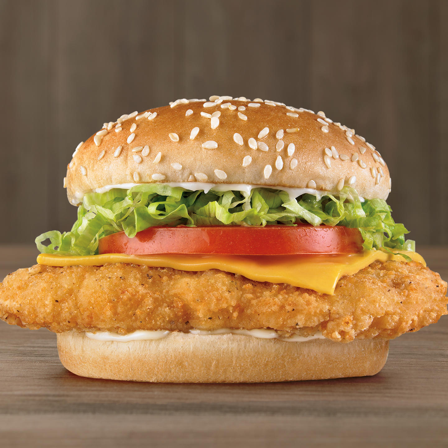 Open your eyes wide and set your sights on a quarter pound* of crispy, juicy, 100% white meat chicken topped with fresh iceberg lettuce and creamy mayo, American cheese, a slice of red-ripe tomato, all on a sesame seed bun.   *Pre-cooked weight