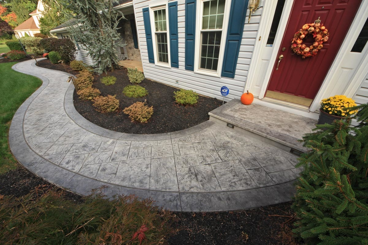 A Stamped Concrete Walkway And Stoop