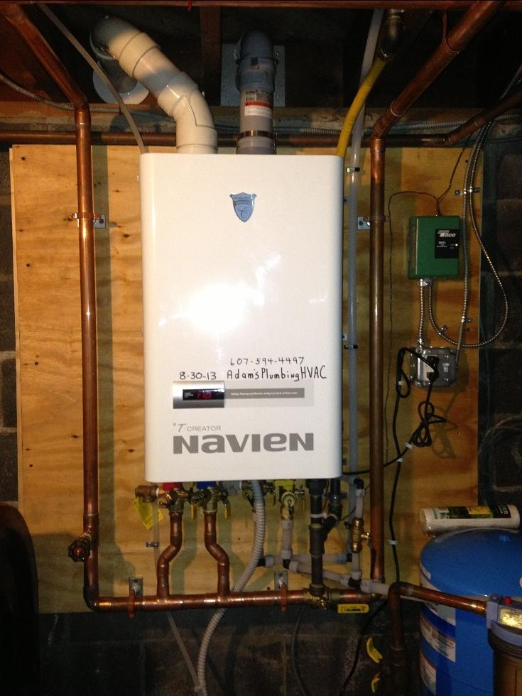 Navien NCB 180 93% Combi boiler / water heater. Replaced a rotted out older oil fired boiler with coil.