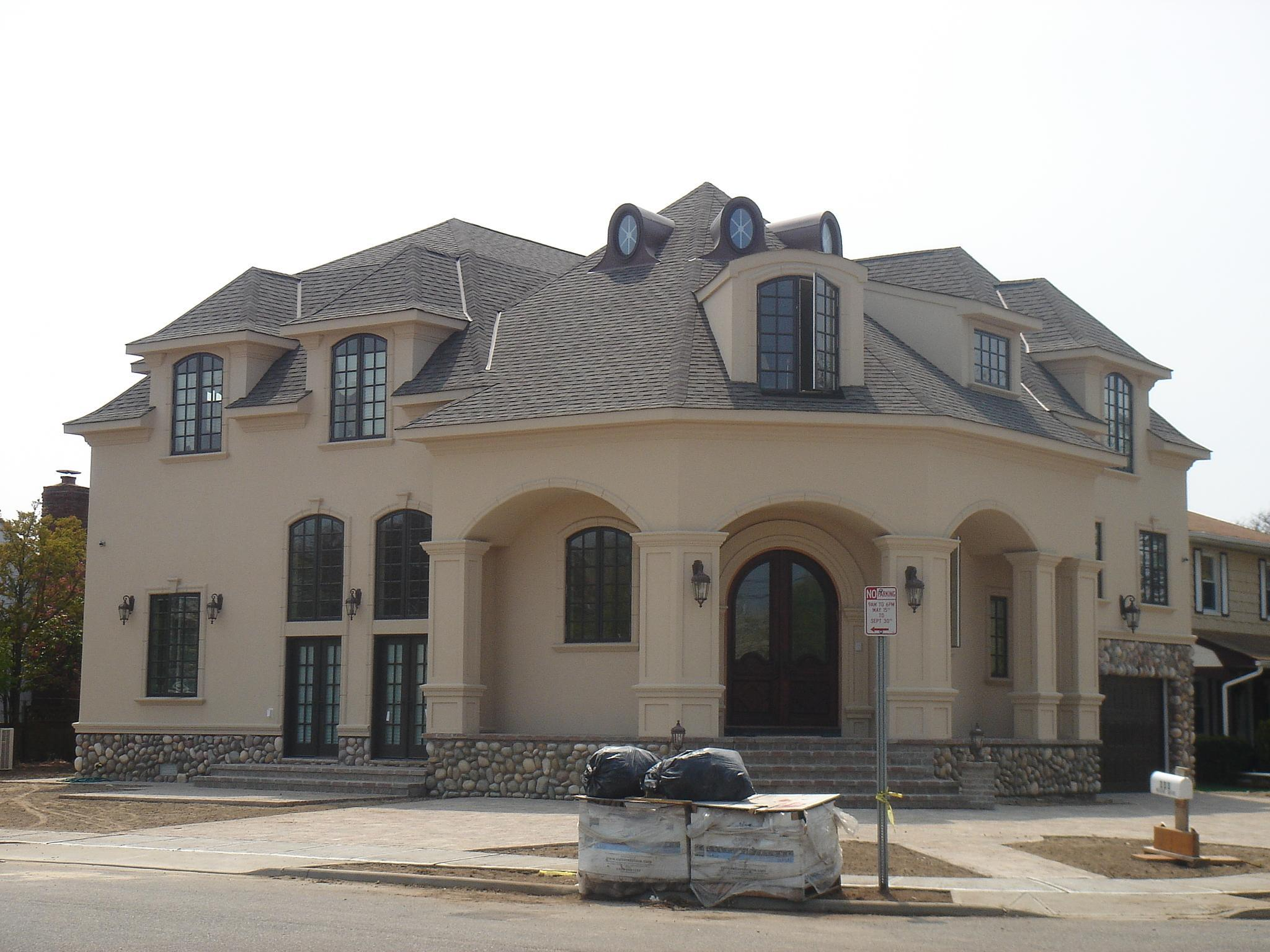 New French 5,000 s.f. med style home on a 8,000 s.f. corner lot configuration. House was designed to accommodate 6 bedrooms. landscape is still under const....