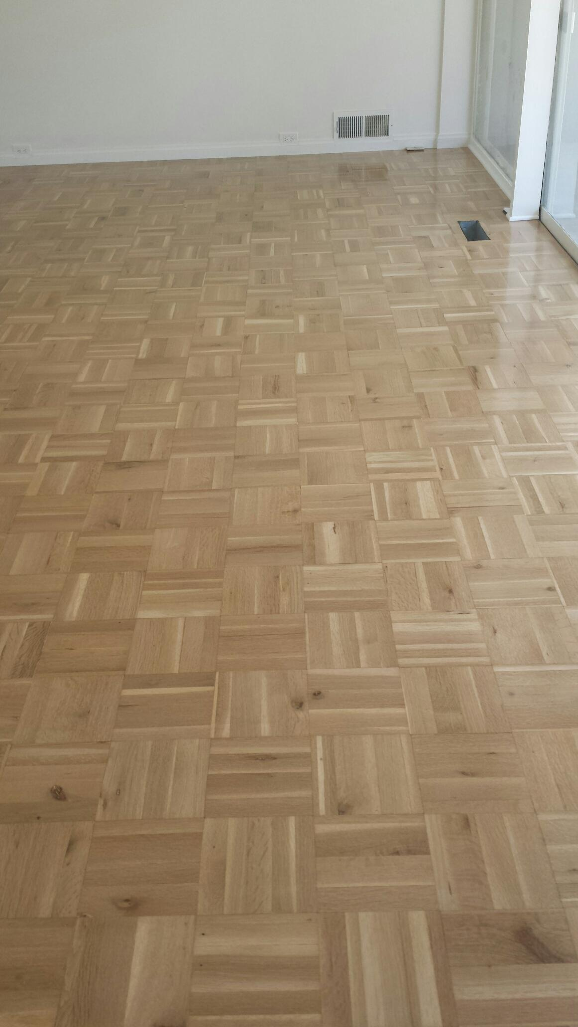 Parquet oak flooring sanded and finished in natural clear finish 4 coats of semi gloss polyurethane.