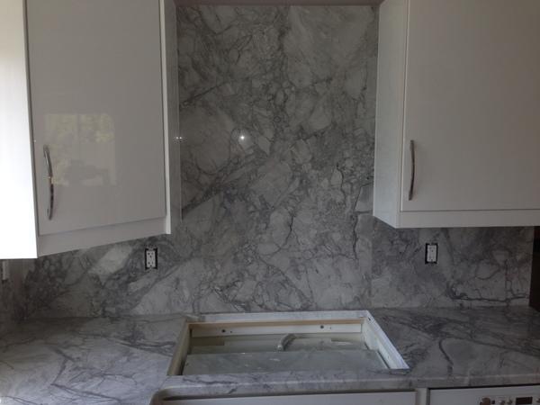 granite countertops with full granite backsplash and cooktop cut out