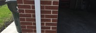 Remove and replace brick matching original mortar joints and color.