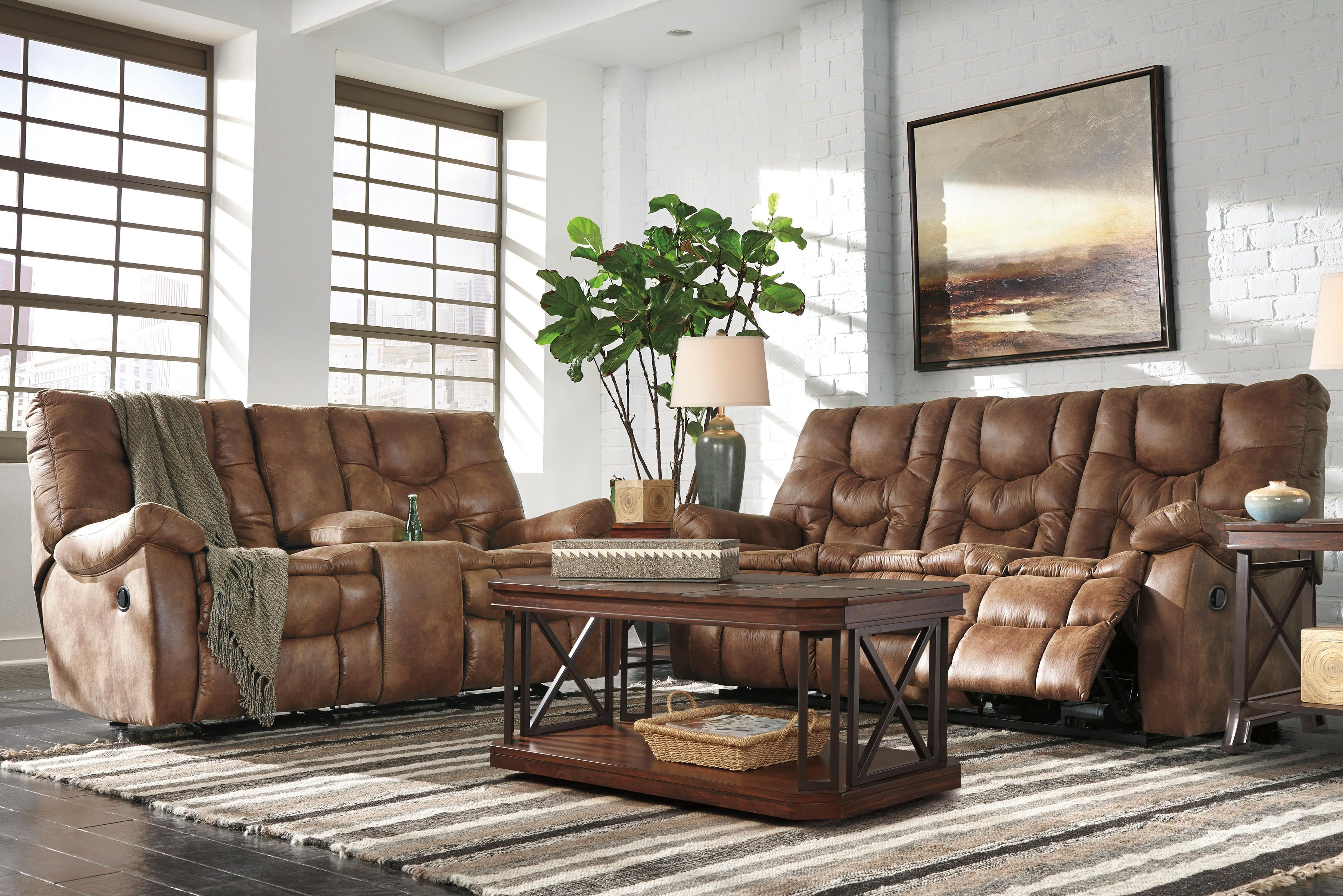 Kick back in the comfort of the Darshmore reclining sofa. Pillowy cushions surround the entire body as you settle in for a movie or sleep marathon. Both sides individually recline at the pull of a tab. Plush upholstery is welcoming and easy-care.