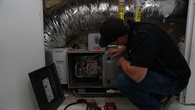 An energy-efficient expert from the Energy Monster team conducts a home energy assessment.