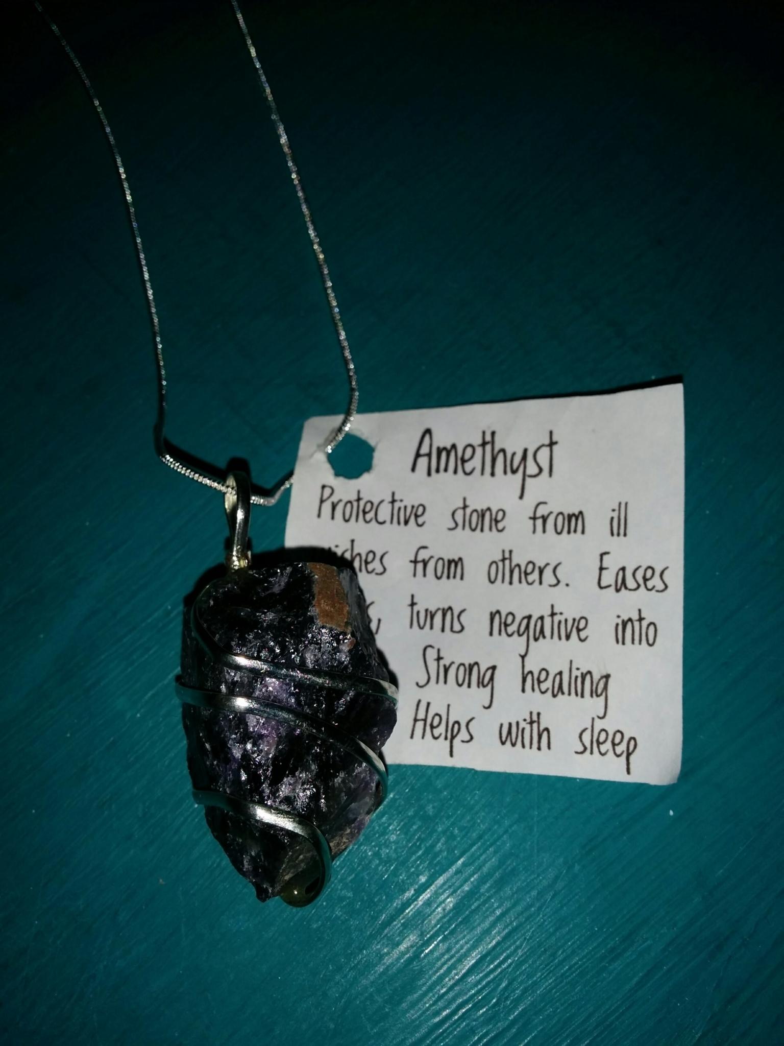 Brassy Lassy Inc in St John's: Amethyst (healing) wire wrapped pendant on sterling chain, $20