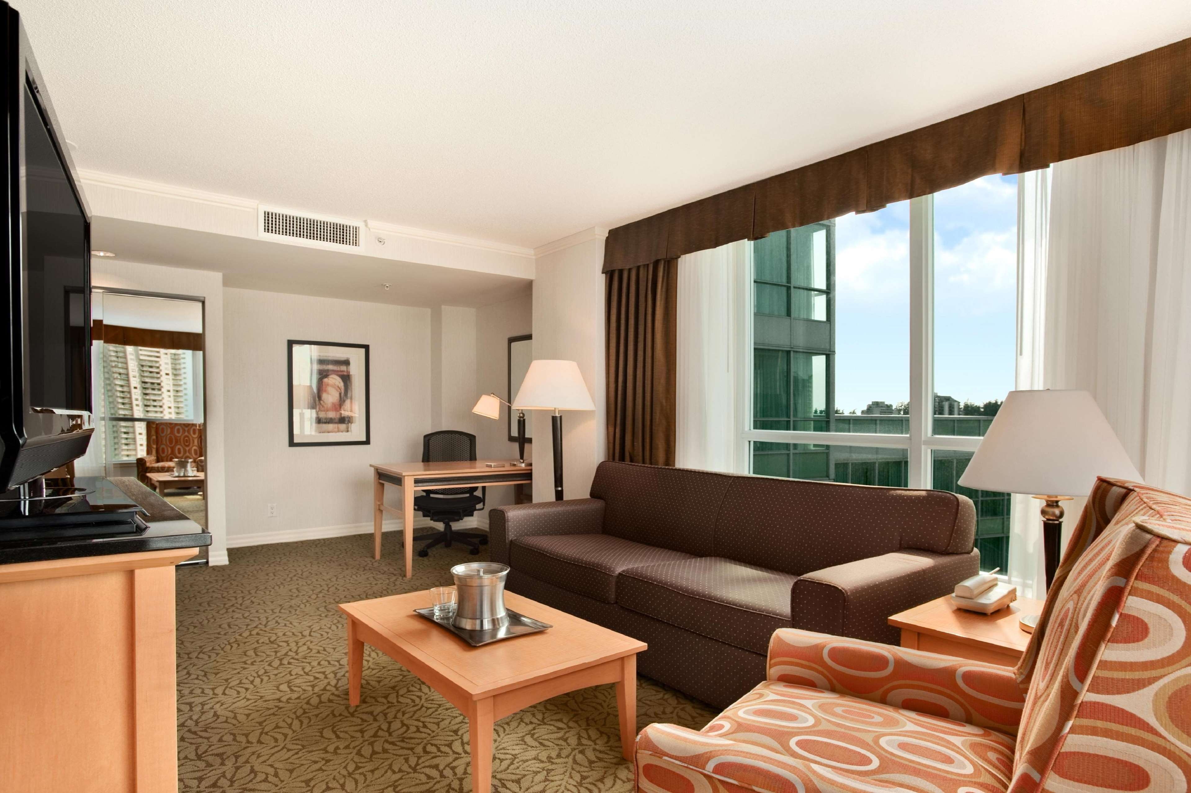 Hilton Vancouver Metrotown in Burnaby: 1 Bedroom Suite Living Area