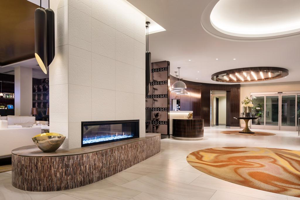 Lobby Fireplace - An elegant entrance complete with a two-way fireplace, stylish light fixtures and beautiful flowers will greet you after spending a day exploring all of the fun things to do in Burba