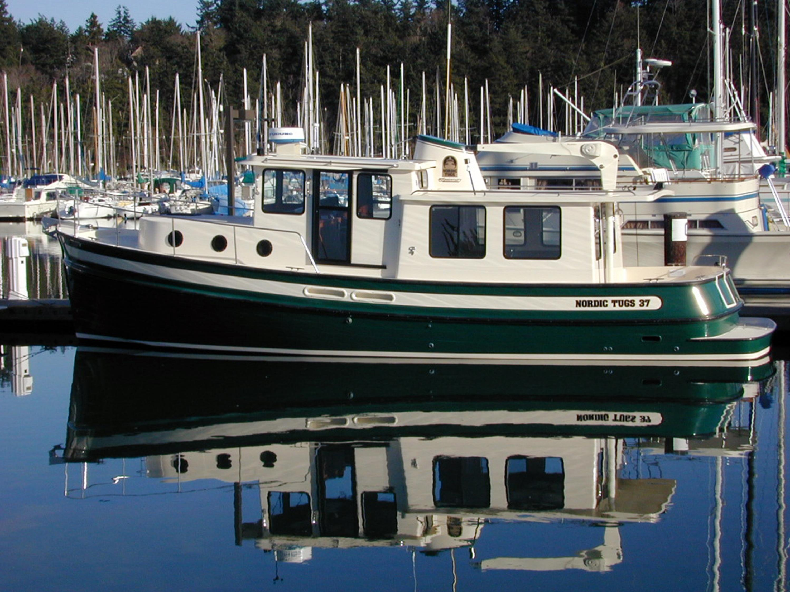 Compass point composites llc coupons near me in camano for Small outboard motor repair near me