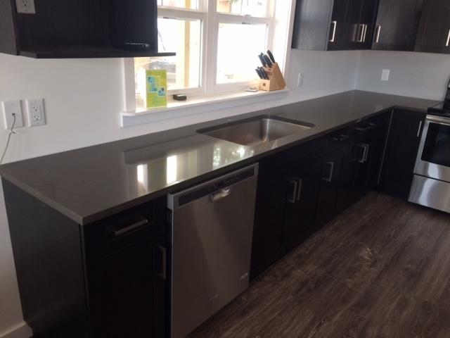 Allcraft Kitchens En' Counters in Williams Lake: Black Oak Cabinets with Quartz
