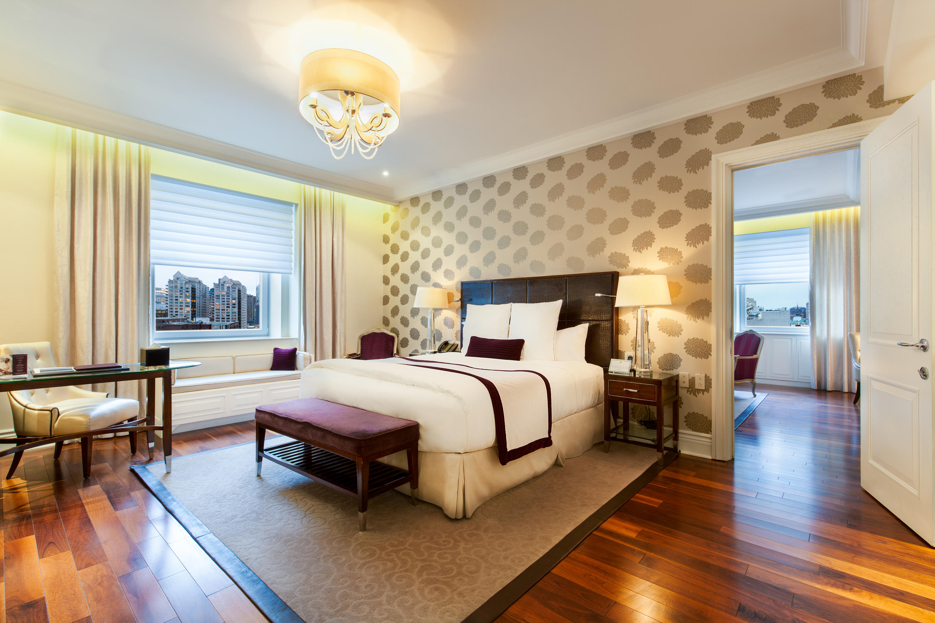 The Ritz-Carlton, Montreal à Montreal: Against sweeping views of Montréal, our One Bedroom Suite is of limitless inspiration and limited quantity—only one of these corner suites is available per fl oor. Lounge beside the original marble fi replace in a living room with a 47-inch LCD fl at-screen TV, complimentary Wi-Fi access and other modern amenities, then unplug in a spacious bathroom with a rain shower and soaking tub.