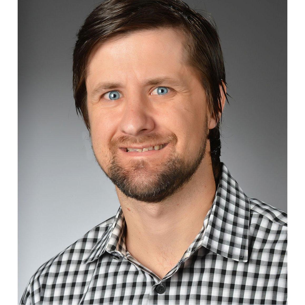 Headshot of Justin Smith