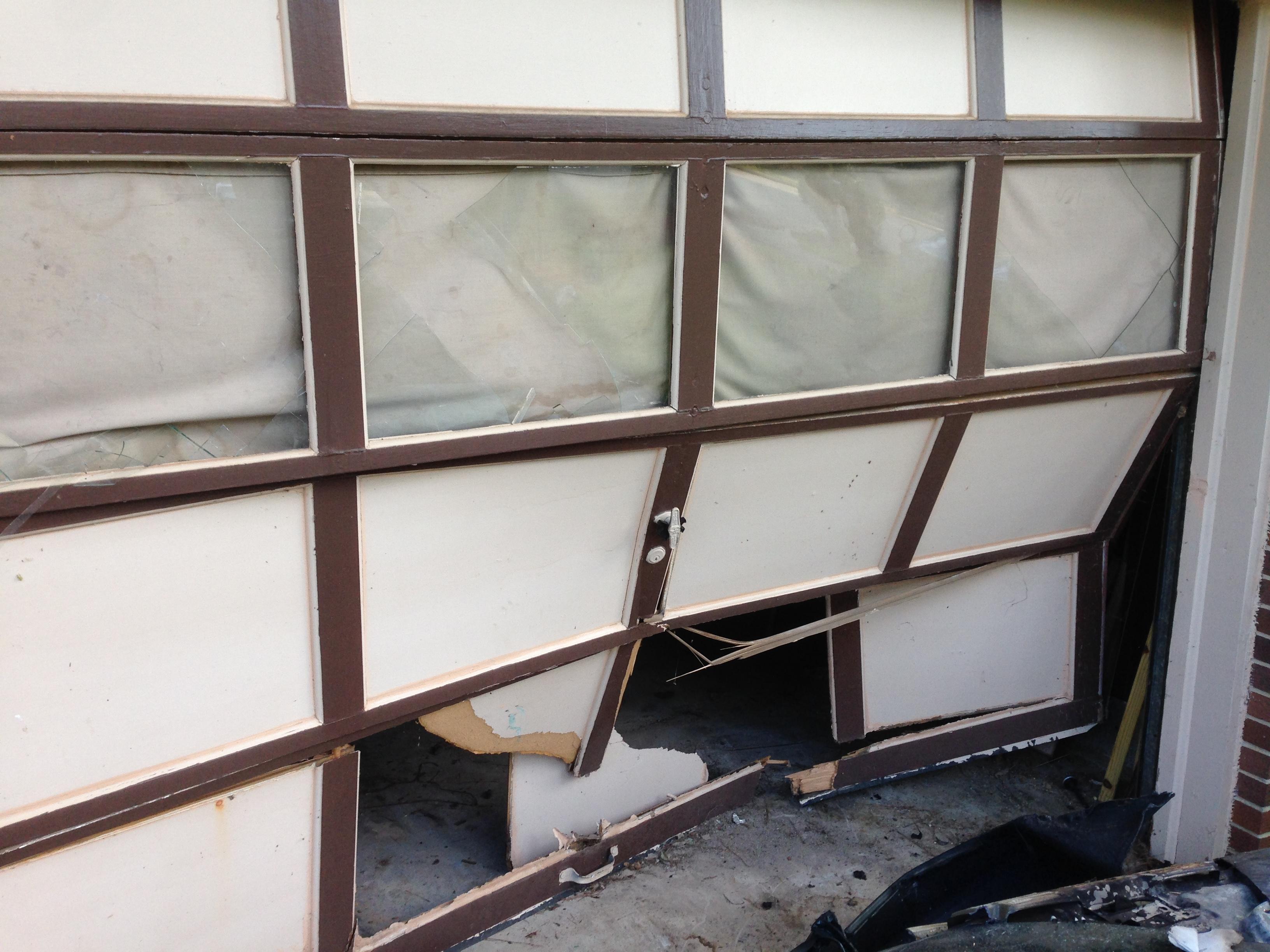 repair of 9x7 wooden garage door replacement with amarr stratford solid garage door