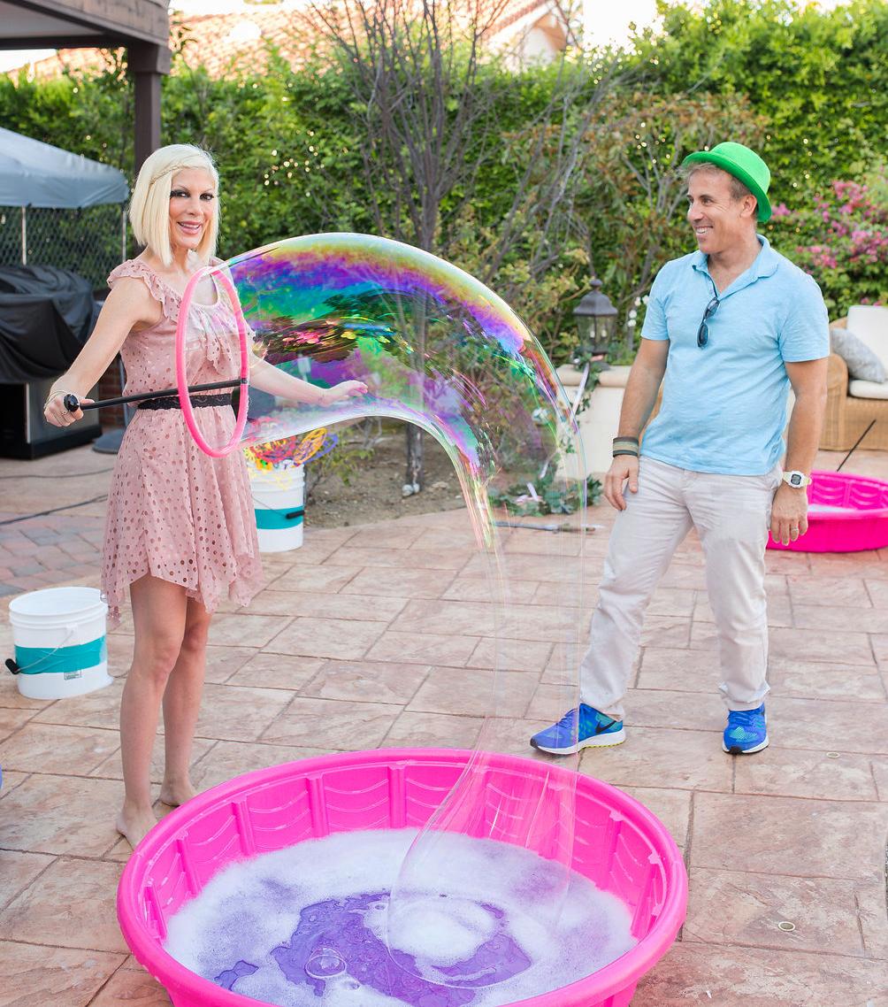 Tori Spelling making bubbles