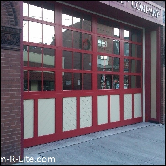American Hose Fire Company glass garage door by Arm-R-Lite to meet city heritage and historical preservation requirements.