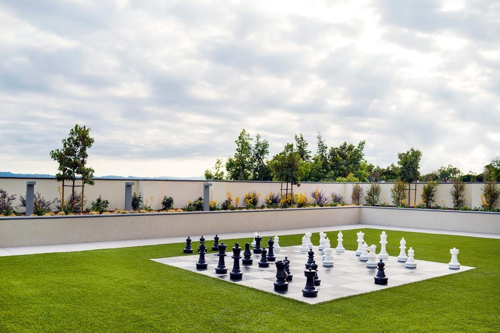 Outdoor Chess Board = Take the fun outdoors to our oversized chess board, featuring fun for all ages.
