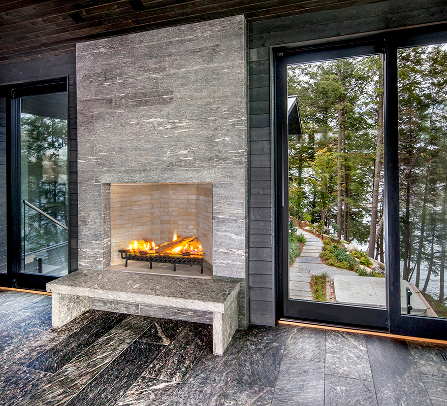 HLD Muskoka in Huntsville: Image of a custom, indoor fireplace built by HLD Muskoka, builders of custom cottages and homes in Muskoka.