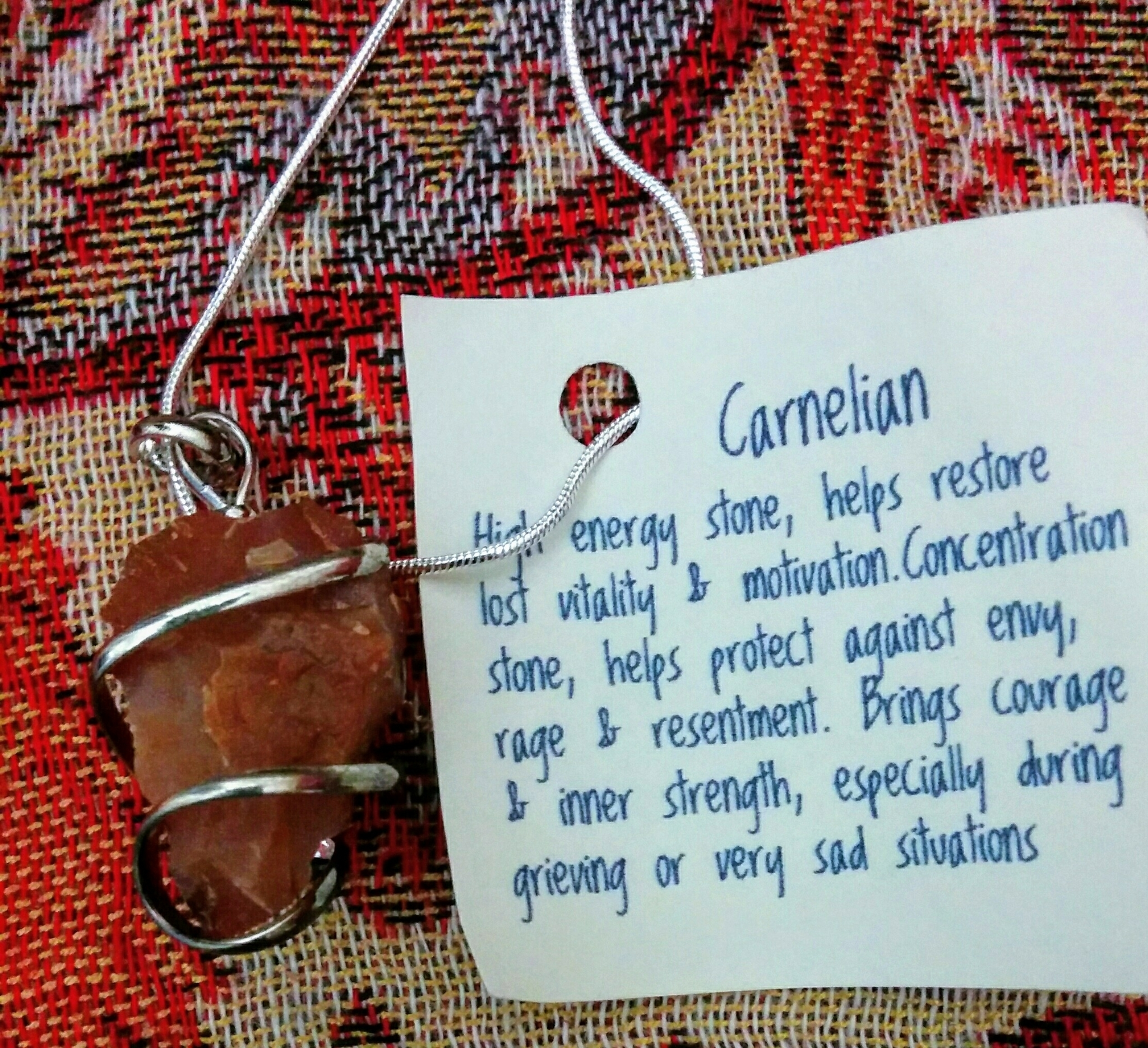 Brassy Lassy Inc in St John's: Carnelian(energy, motivation) wire wrapped pendant on sterling chain, $20